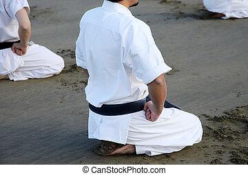 Japanese karate martial arts training at the beach