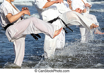 Japanese karate martial arts training at the beach