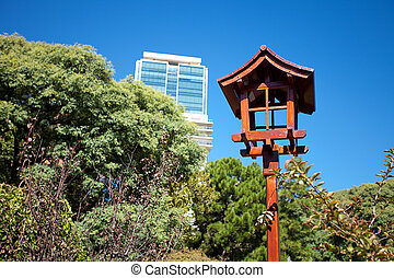 Japanese lantern on a background of blue sky and the skyscraper