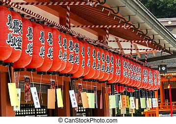 Japanese lanterns, hanging at a shinto shrine, kyoto - Rows...