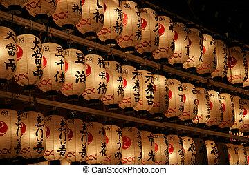 Japanese Lanterns - Japanese lanterns lit up at night.
