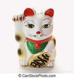 Japanese lucky cat. - Japanese lucky cat figurine.
