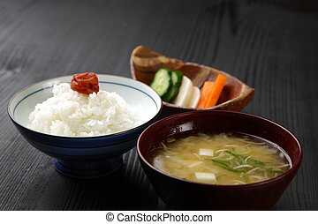 Japanese meal - studio shot of rice with pickled plum,miso...