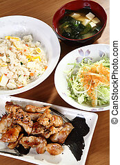 Japanese menu with chicken, rice and vegetables