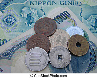 all the japanese coins in use now and as background two 1000 yens bills