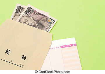 Japanese money and bankbook with salary bag on a table