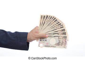 Hand holding Japanese banknote on white background.