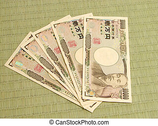 50000 yens bills on a tatami floor