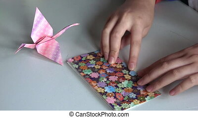 Japanese paper folding origami - Japanese woman hands...