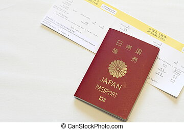 Japanese passport and immigration card (red)