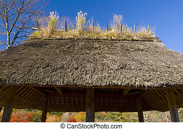 Japanese Pavilion - A thatched roof pavilion in a Park in...