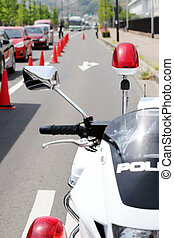 Japanese police motorcycle with red lamp