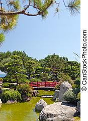 Japanese red bridge in zen garden