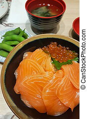 japanese rice with raw salmon and salmon roe (Salmon donburi) with miso soup and edaemame.
