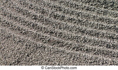 Japanese Rock Garden - Close up of raked sand in a rock...