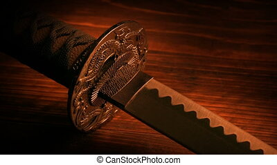 Japanese Samurai Sword In Fire Light - Samurai sword on...