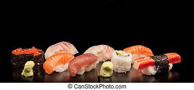 Japanese seafood sushi, on black background