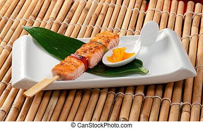 Japanese skewered salmon Yakitori .closeup