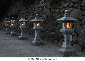 Japanese stone lanterns in the evening