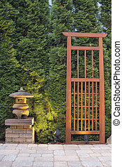 Japanese Stone Pagoda Lantern and Trellis in Backyard Paver...