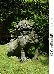 Japanese stone statue of a lion