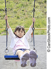 Japanese student girl on the swing (6 years old)