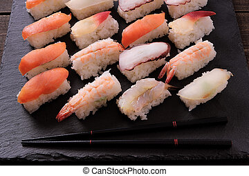 Japanese sushi platter various different with chopsticks
