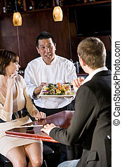 Japanese sushi restaurant, chef serving customers - Japanese...