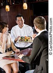 Japanese sushi restaurant, chef serving customers - Japanese...