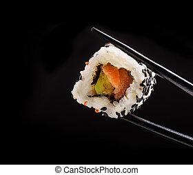 Japanese sushi roll on black background