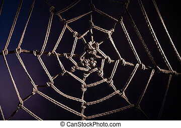 Japanese traditional technique of knitting shibari ropes in the form of a spider web. No people. Part of the bedroom interior. BDSM.