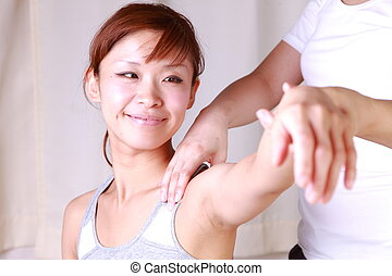 chiropractic - Japanese woman getting chiropractic