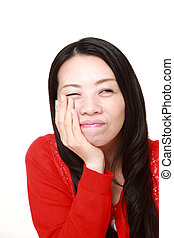 Japanese woman suffers from toothache