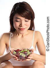 Japanese woman with bowl of fruit