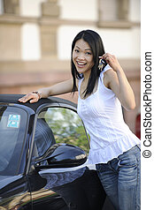 japanese woman with her new car