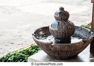 Jar fountain decorated home garden