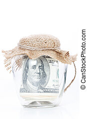 Jar full of money on white background