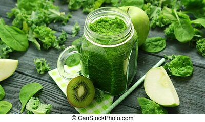 Jar glass with green smoothie - From above shot of green...