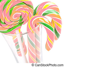 Jar of candy canes on white background