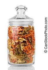 Jar of colored pasta Farfalle isolated on white background.