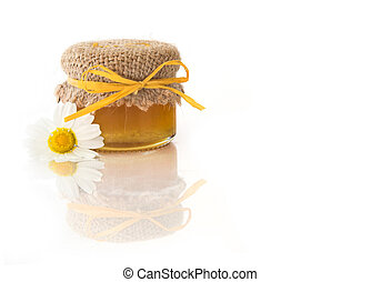 Jar of honey isolated on white