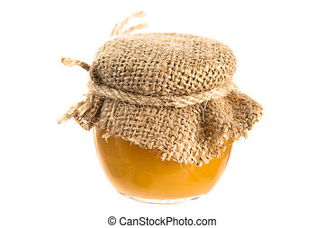 jar of honey, it is isolated on white