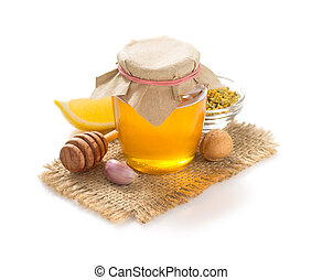 jar of honey on white background - glass jar of honey...