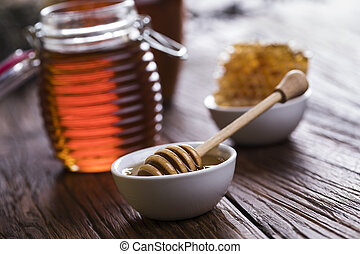 Jar of honey with honeycomb - Honey in the comb, glass jar...