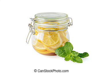 Jar of lemons on a white background
