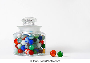 jar of vintage marbles isolated on a white background