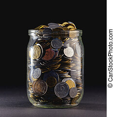Jar of Money Isolated on a black Background
