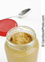 Jar of peanut butter on white background