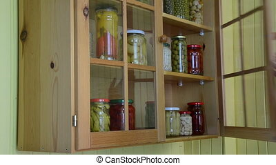 jar pickled vegetable - girl from a kitchen dresser takes...