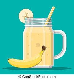 Jar with banana smoothie with striped straw.